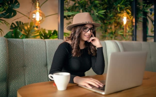 Woman creating blog on her computer