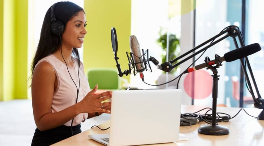 Woman using software to do Podcast