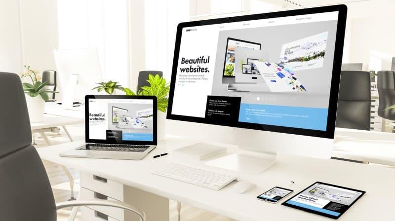 computer screens showing building websites