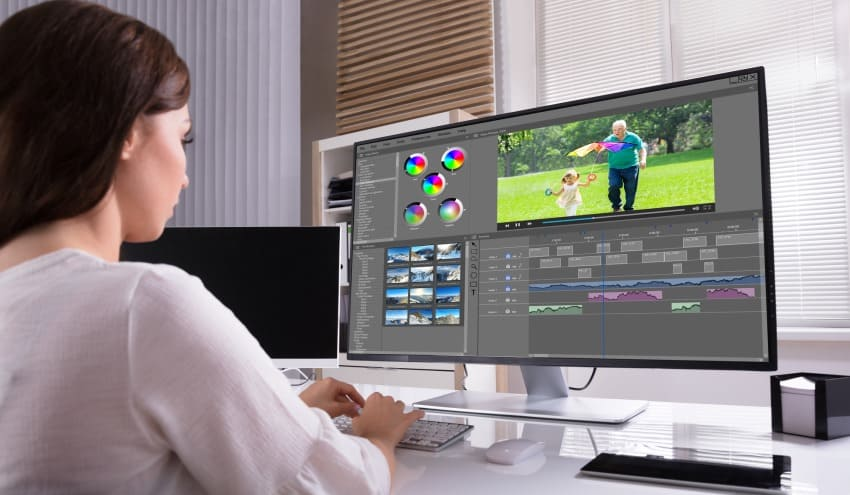 Woman editing video for YouTube