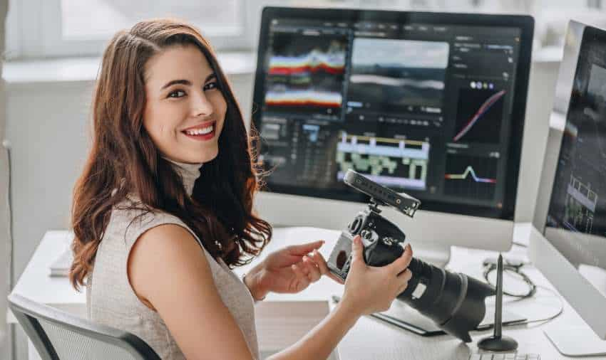 Woman with Camera editing videos