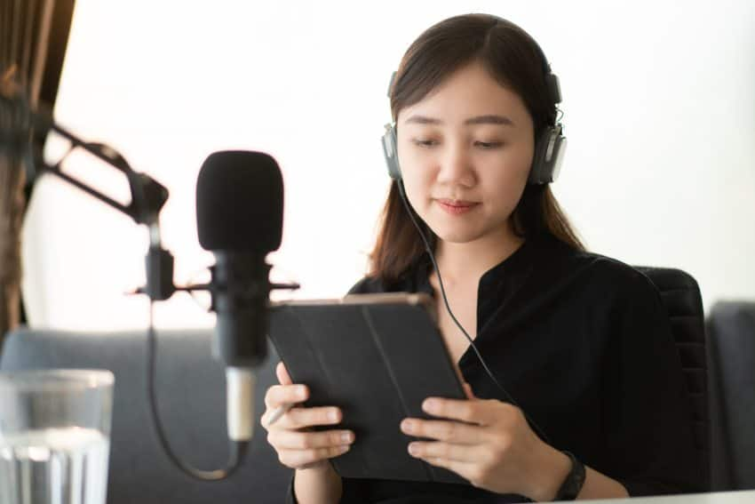Woman publishing her podcast on her tablet