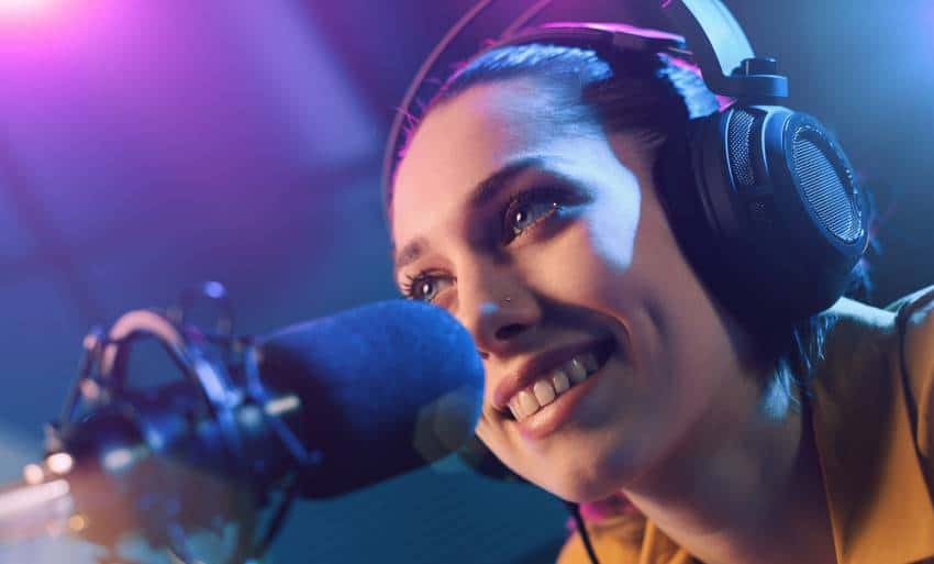woman using podcast hosting for her show
