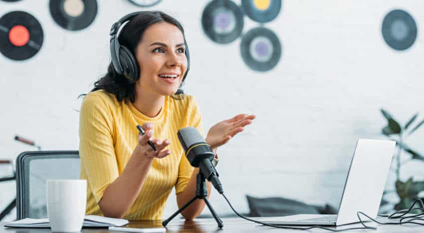 Woman working on podcast to upload to spotify
